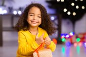 Winter Happiness. Adorable Happy Little African Girl Enjoying Christmas Gift, Empty Space poster