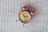 Clock At 10 O Clock In The Morning With Vintage Style Alarm Clock On Knitted Background. Windup Type poster