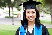 Beautiful Young Asian Woman In Graduation Cap And Gown