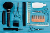 Professional Hairdresser Tools On Blue Background. Barber Equipment On Wooden Table. Beauty Salon An poster
