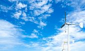 Wind Turbine At Wind Farm On Blue Sky. Alternative And Renewable Energy Concept. Sustainable Electri poster