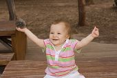 Beautiful And Happy Baby Girl Playing In The Park
