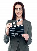 Business Lady Holding Clapperboard