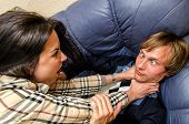 Office Fight: Woman Trying To Stifle A Man On The Sofa