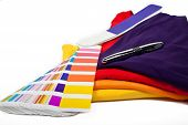 stock photo of ballpoint  - several t shirts and color scale with ballpoint pen - JPG
