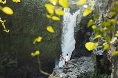 Couple Travel In Pregnancy. Amazing View Of Tegenungan Bali Cascade Waterfall Landscape. Morning Sun poster