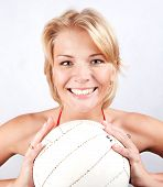 sports blonde with a ball