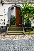 stock photo of wine-press  - Old Screw Press for Pressing Grapes in Courtyard Germany - JPG