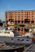 Tall View Across Moored Boats At The Albert Dock In Liverpool On A Sunny Day poster