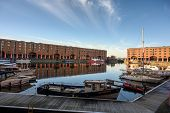 Wide View Of The Albert Dock In Liverpool On A Sunny Day. Many Small Boats Are Moored Around The Sid poster