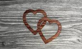 Cute two hearts symbol in a wooden background