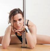 image of lap dancing  - The young beautiful woman is engaged at a pole - JPG