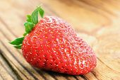 Strawberry On A Old Wooden Table