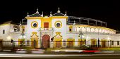 "stock photo of old spanish trail  - ""La Maestranza"" bullfight arena night view in Seville, Spain - JPG"
