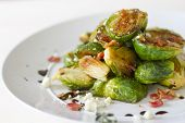 stock photo of brussels sprouts  - Carmelized brussel sprouts with bacon blue cheese thyme and balsamic reduction - JPG