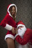 Santa Claus and Mrs. Santa is very excited with their pregnancy.