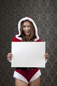 Mrs. Clause is showing and blinking us an blank white paper. Designers can easily put their own mess