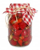 Pickled chili peppers in glass jar