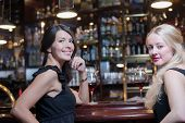 Two Women Drinking At An Upmarket Hotel