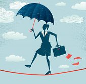 Abstract Businesswoman walks the Tightrope with Protection.