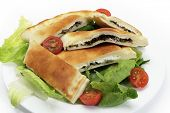 Arabian traditional spinach and labneh (cream cheese) fataya, a sort of Arab calzone, made from a fl