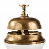 stock photo of over counter  - an old hotel bell isolated over a white background - JPG