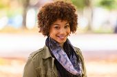 image of adolescent  - Autumn outdoor portrait of beautiful African American young woman  - JPG