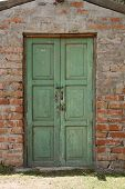 Green Door in Adobe Wall