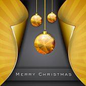 Merry Christmas celebration concept with hanging golden Xmas balls on golden and grey background.