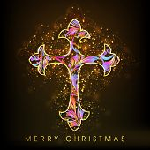 Merry Christmas celebration concept with colorful Christian Cross on shiny brown  background.