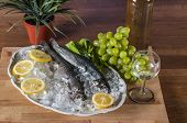 Mediterranean composition with raw fish