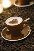 Cappuccino decorated with cocoa valentine