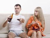 foto of rutin  - Couple sits on the couch - JPG