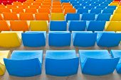 image of grandstand  - Blue and Orange Empty Seats in a Grandstand - JPG