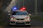 Ningi, Australia - November 9 : Police Holding Cordon In Front Of Bush Fire Front As It Approaches H