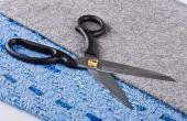 Sharp Scissors Against A Fabric