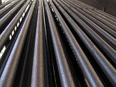 Steel Tubes Of The Heat Exchanger, The Water Heater In The Boiler Grate As Background