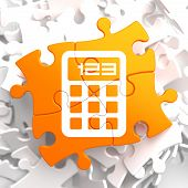 Calculator Icon on Orange Puzzle.