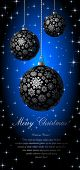 Merry Christmas card with silvery balls on blue background.