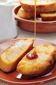 a plate with torrijas, typical spanish dessert for Lent and Easter, on a table