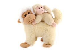 picture of stuffed animals  - Family of monkeys the small child on a back at the parent - JPG