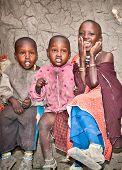AFRICA, TANZANIA-FEBRUARY 9, 2014: Portrait on an African Kids of Masai  tribe village smiling to th