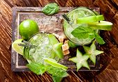 Mojito lime drinks on wooden background, upper view