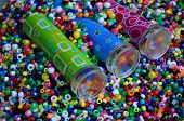 pic of kaleidoscope  - Three different kaleidoscopes sitting in colorful beads