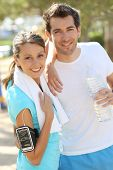 Cheerful couple of joggers looking at camera
