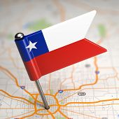 Chile Small Flag on a Map Background.