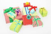 Many colorful presents with luxury ribbons  on color carpet background