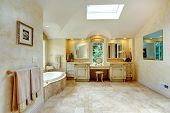 stock photo of bath tub  - Spacious luxury bathroom with high vaulted ceiling and velux window - JPG