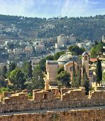 The morning sun illuminates the dome. The Church  in Jerusalem. Battlements of Jerusalem surrounded