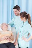 Elderly Woman Talking To Doctors